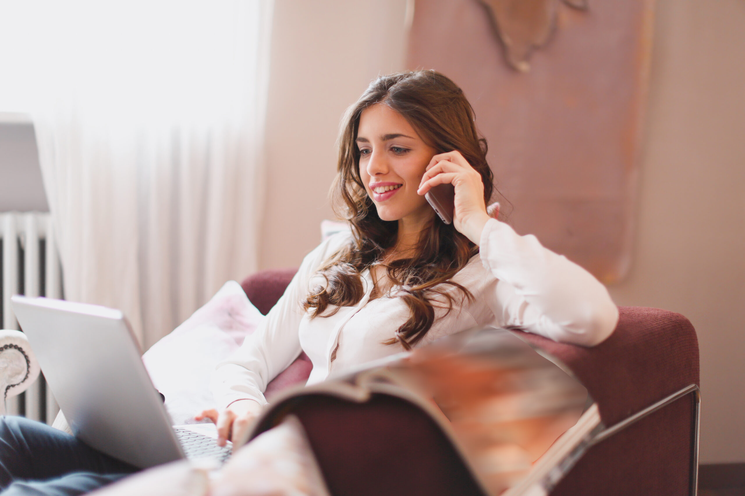 Ilana Integrative Health woman-in-white-long-sleeve-shirt-sitting-on-brown-chair-3768590-1-scaled Services